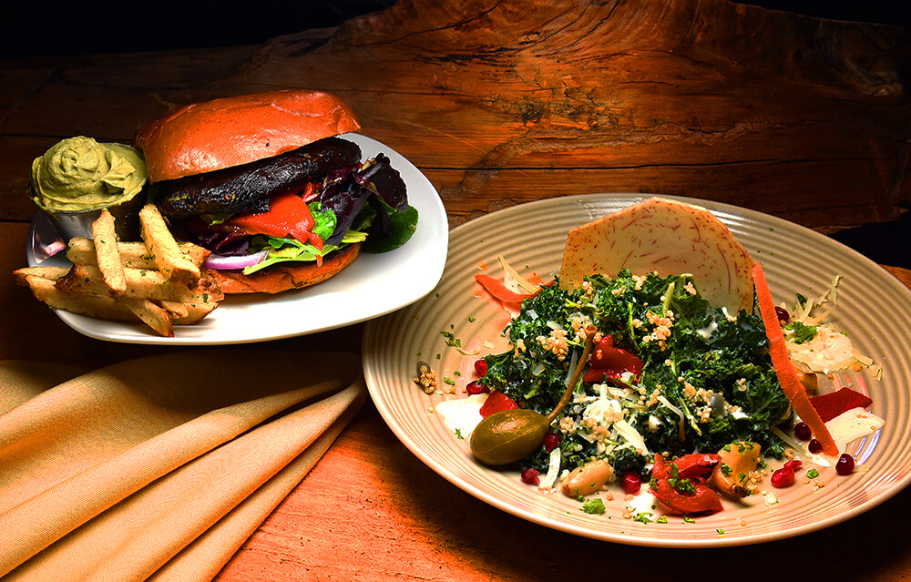 Portobello Mushroom Sandwich on a Brioche Bun with Avocado Mousse and Massaged Kale Caesar Salad Organic Kale