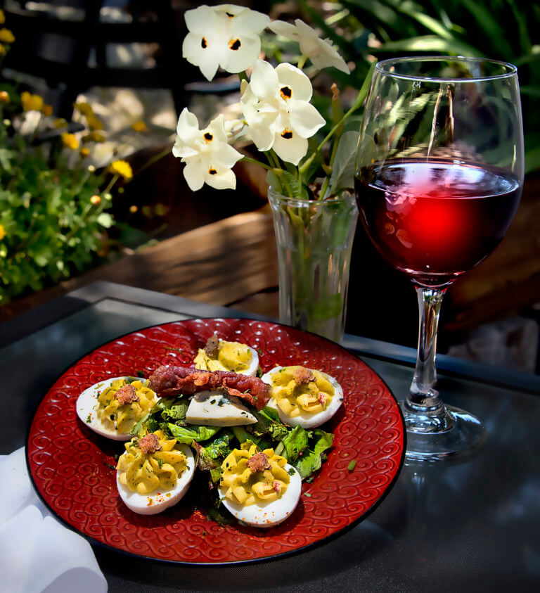 Six Deviled Eggs topped with Bacon Jam, Blue Cheese and Crispy Prosciutto