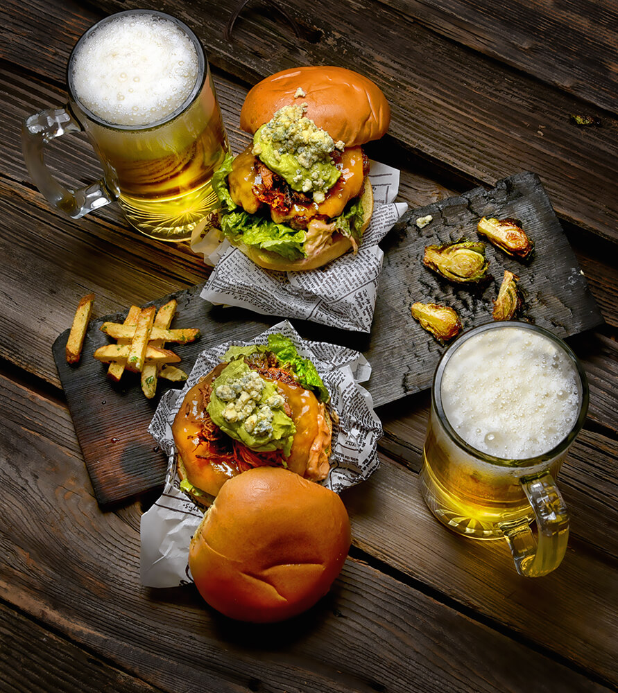 Organic Grass Fed Burgers on Brioche Bun with House Made Garlic Herb Fries and Local Nickel Beer on Draft