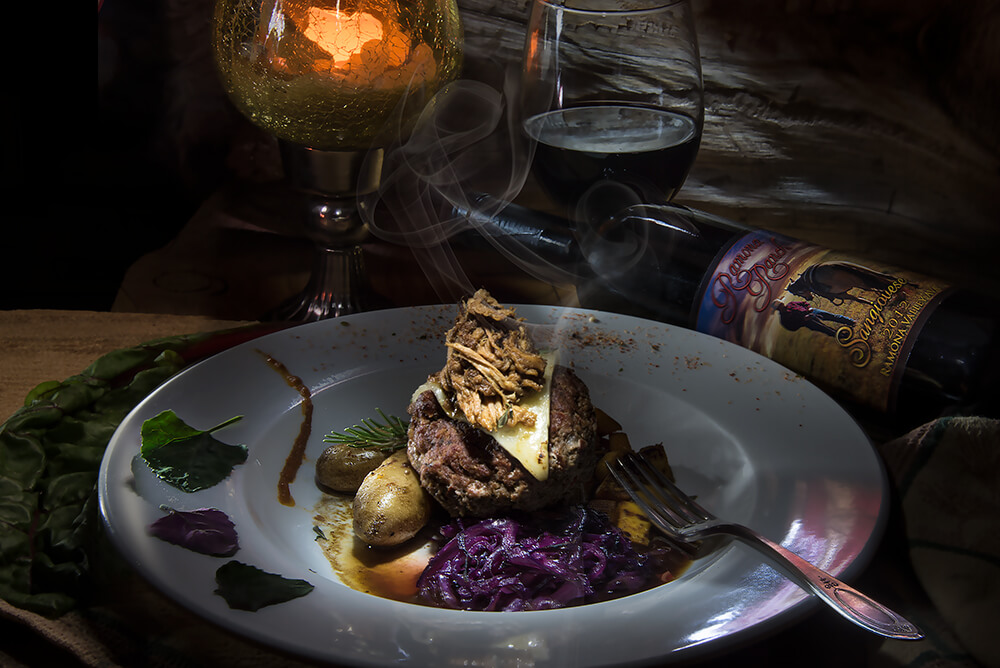 Star B Ranch Grass Fed Bison Meatloaf with Organic Fingerling Potatoes from Sage Mountain Farms, Braised Red Cabbage, Butternut-Kale Sauté, Pork Brisket, Manchego Cheese and Pork Jus