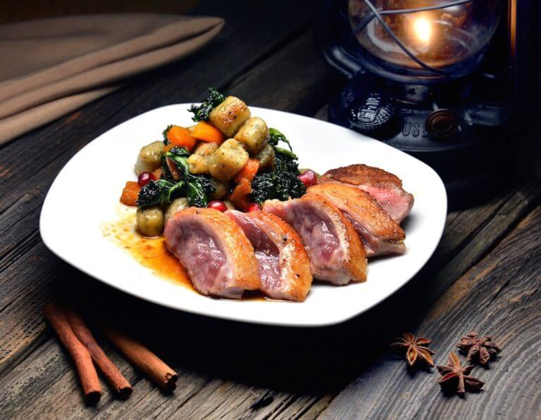 Seared duck breast with Gnocci and Butternut Squash Kale Sautee