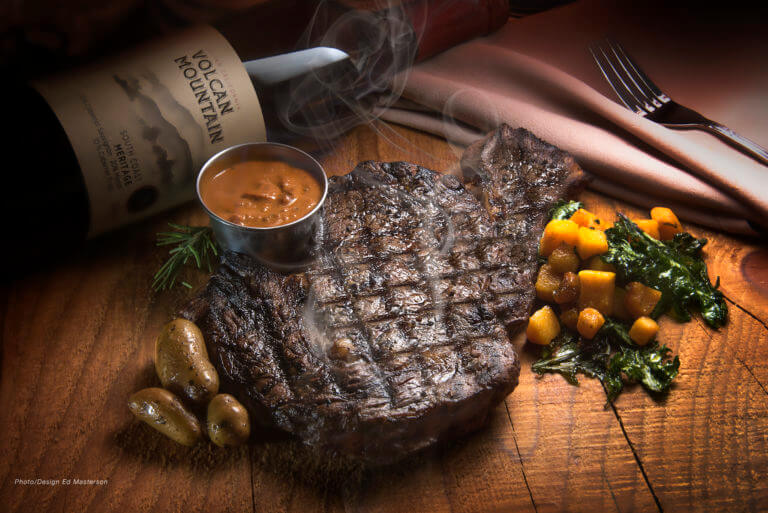 Flame Grilled 15oz Rib Eye Steak with Organic Fingerling Potatoes, Butternut Squash - Kale Sauté and Caramelized Onion Volcan Mountain Winery
